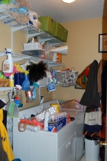 BEFORE: Cramped, cluttered, and ordinary laundry room.